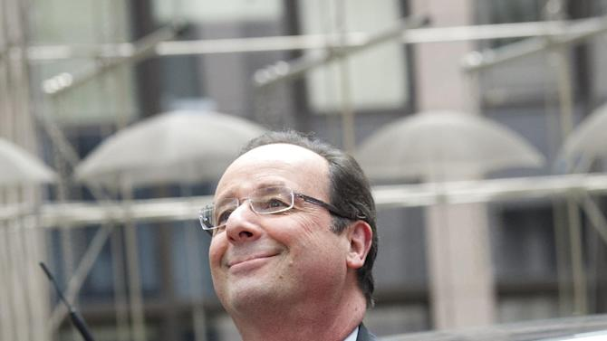 French President Francois Hollande arrives for an EU summit in Brussels on Thursday, June 27, 2013. European Union leaders meet in Brussels ostensibly to agree on ways to find more jobs for the young, who've been disproportionately punished by years of crisis and recession.(AP Photo/Geert Vanden Wijngaert)