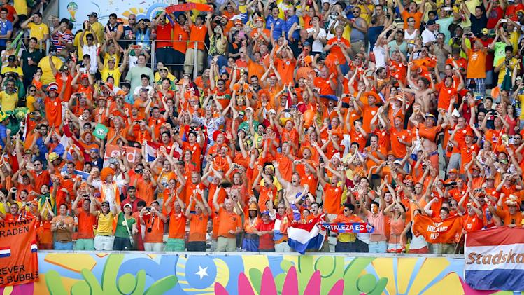 Dutch fans celebrate after the Netherlands defeated Mexico 2-1 to advance to the quarterfinals during the World Cup round of 16 soccer match between the Netherlands and Mexico at the Arena Castelao in Fortaleza, Brazil, Sunday, June 29, 2014