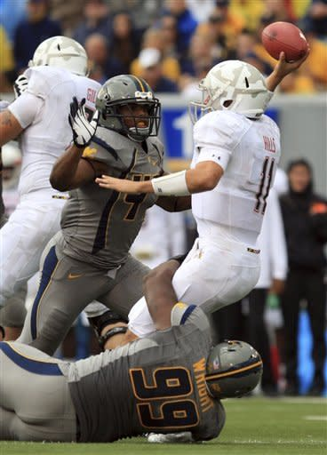 No. 8 West Virginia outlasts Maryland 31-21