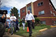 Daniel King, chief trial deputy with the Colorado State Public Defender's Office, walks away from the apartment building where accused killer James Holmes lived, as his team gathered evidence on July 25, 2012 in Aurora, Colorado