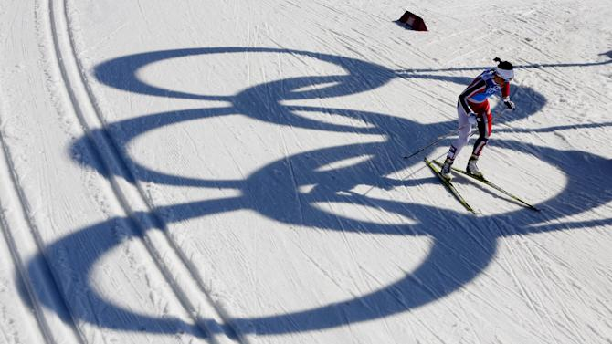 Norway's Marit Bjoergen skis past the Olympic rings during the women's 4x5K cross-country relay at the 2014 Winter Olympics, Saturday, Feb. 15, 2014, in Krasnaya Polyana, Russia. (AP Photo/Dmitry Lovetsky)