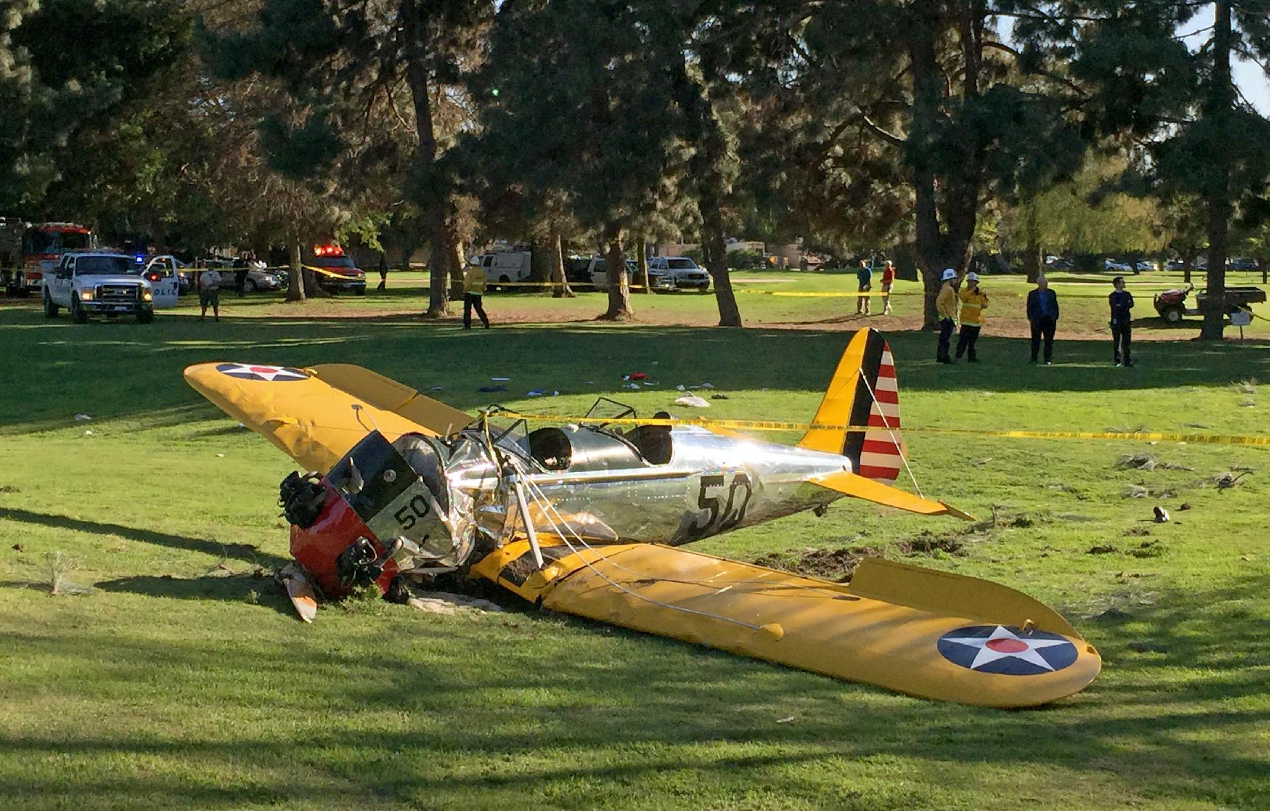 Harrison Ford crash lands vintage plane on golf course