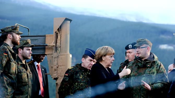 German Chancellor Angela Merkel , center,  visits German soldiers in Kahramanmaras, Turkey Sunday Feb. 24, 2013.  German Chancellor Angela Merkel is visiting German troops deployed to operate Patriot missile batteries in Turkey. The Patriots were sent to Turkey, a NATO member, to protect it from spillover from Syria's civil war. Merkel's two-day visit comes as Turkey grows increasingly frustrated over the slow progress in its bid for European Union membership. Before arriving Sunday, Merkel said she backs opening a new chapter in those stalled talks, despite being skeptical about Turkey's accession.  The chancellor's first stop was Kahramanmaras, some 100 kilometers (60 miles) from the Syrian border, where some 300 German troops are manning two out of six NATO-deployed anti-missile batteries. (AP Photo/dpa, Kay Nietfeld)