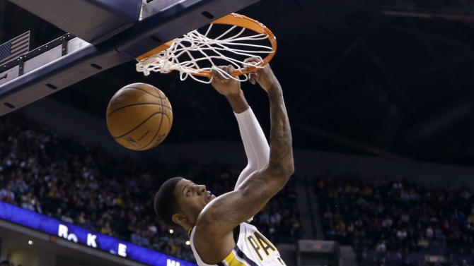 Indiana Pacers forward Paul George gets a reverse dunk over Chicago Bulls forward Taj Gibson in the second half of an NBA basketball game in Indianapolis, Monday, Feb. 4, 2013. The Pacers defeated the Bulls 111-101. (AP Photo/Michael Conroy)