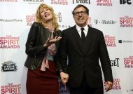 "Director David O.Russell poses backstage with presenter actress Laura Dern after ""Silver Linings Playbook"" won four awards, including best feature, at the 2013 Film Independent Spirit Awards in Santa Monica, California February 23, 2013. REUTERS/Phil McCarten"