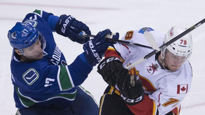 Lack helps Canucks top Flames 4-1, even series
