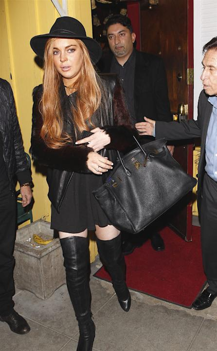 Celebrities in thigh high boots: Lindsay Lohan wore her thigh high leather boots for dinner with friends. Copyright [Splash]