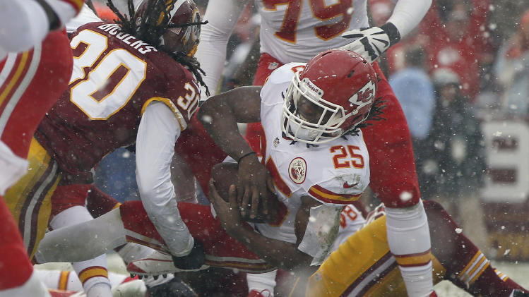 Kansas City Chiefs running back Jamaal Charles gets by Washington Redskins free safety E.J. Biggers (30) and carries the ball into the end zone for a touchdown during the first half of an NFL football game, in Landover, Md., Sunday, Dec. 8, 2013