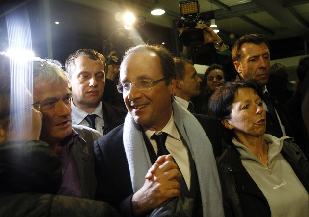 French socialist candidate for the presidential election Francois Hollande, center, arrives at Brive airport in Brive, Central France, after the first round of the presidential election, Sunday, April 22, 2012. (AP Photo/Christophe Ena)