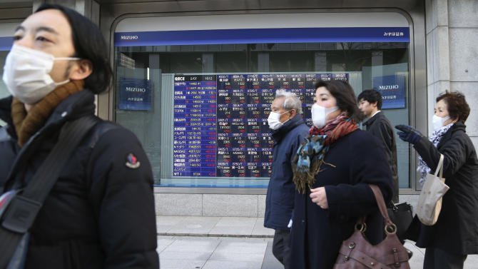 People walk by an electronic stock board of a securities firm in Tokyo, Friday, Feb. 7, 2014. Asian stock markets were mostly higher Friday, mirroring gains on Wall Street in anticipation of a positive U.S. jobs report for January. Japan's benchmark Nikkei 225 index surged 1.6 percent to 14,382.77. (AP Photo/Koji Sasahara)
