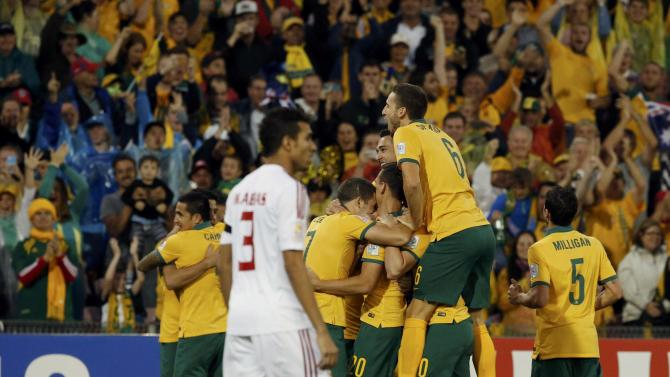 Australia's Trent Sainsbury celebrates with teammates after scoring a goal against UAE during their Asian Cup semi-final soccer match at the Newcastle Stadium in Newcastle