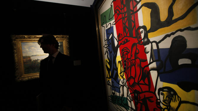 """A painting by Fernand Leger entitled """"The Outing (Le Partie de Campagne),"""" right, is displayed at the Sotheby's selling exhibition of Impressionist and Modern Art in Hong Kong Thursday, Nov. 25, 2010. For newly minted Chinese billionaires looking to spend their money, a natural choice has been art and antiques from their own country, many costing millions of dollars. (AP Photo/Kin Cheung)"""