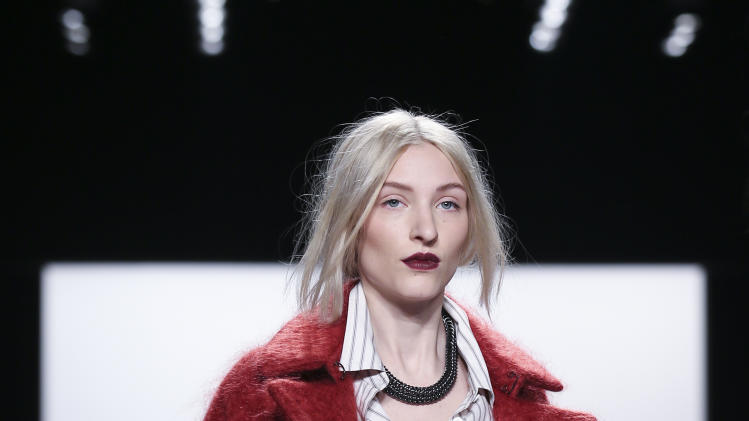 The Rebecca Minkoff Fall 2014 collection is modeled during Fashion Week, Friday, Feb. 7, 2014, in New York. (AP Photo/John Minchillo)