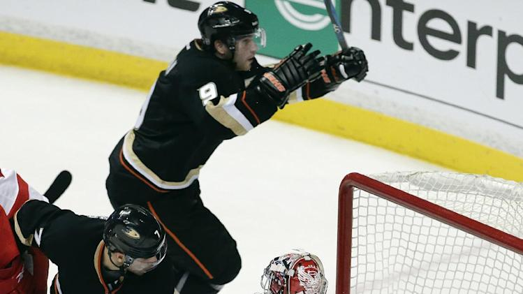 Anaheim Ducks right wing Bobby Ryan, top, celebrates his goal past Detroit Red Wings goalie Jimmy Howard as Andrew Cogliano looks on during the third period in Game 2 of their first-round NHL hockey Stanley Cup playoff series in Anaheim, Calif., Thursday, May 2, 2013. (AP Photo/Chris Carlson)