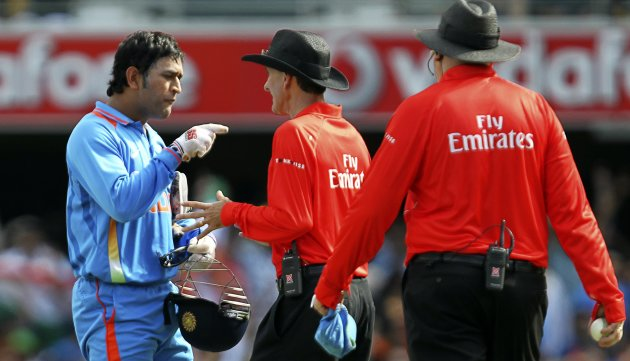 India's Dhoni argues with umpire Bowden after his appeal for the wicket of Hussey was overturned and given not out during their one-day international cricket match in Brisbane