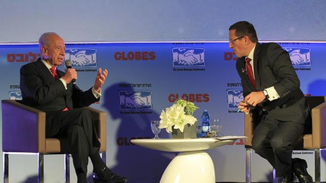 "Israel's President Shimon Peres, left, speaks as CNN's foremost international business correspondent and presenter Richard Quest listens during the Israel Business Conference in Tel Aviv, Israel,Sunday, Dec. 9, 2012. Peres said on Khaled Mashaal's visit to Gaza ""He unmasked the real nature of Hamas; a terrorist organization committed to killing and to conquering and opposed to compromise. There is no doubt that his intention is war and murder while the people of Gaza need economic prosperity.  Israel faces a choice between Gaza and the West Bank, between Hamas and President Abbas. The alternative to Hamas is Abbas, he is a serious man who has declared himself in favor of peace and compromise, of a demilitarized Palestinian state and against terror. He declared that there wouldn't be a Palestinian state in his hometown of Safed. He is for the two-state solution. We have two clear choices, nobody is perfect but one is right and the other is wrong. We have two choose between Mashaal and Abbas."" (AP Photo/Ariel Schalit)"