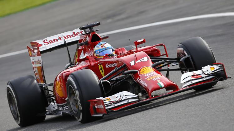 Ferrari Formula One driver Alonso takes a curve during a practice session at the Belgian F1 Grand Prix in Spa-Francorchamps