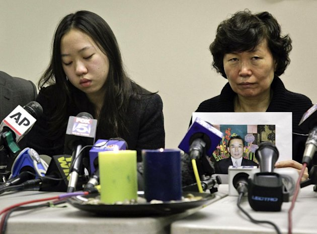 Serim Han , right, holds a picture of her husband Ki-Suck Han as she sits next to their daughter Ashley Han, 20, during a news conference on Wednesday, Dec. 5, 2012 in New York. A homeless man was arrested Wednesday in the death of Ki-Suck Han, who was pushed onto the tracks and photographed just before a train struck him. (AP Photo/Bebeto Matthews)