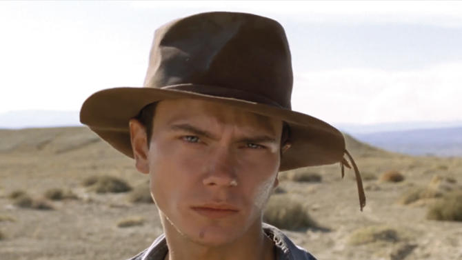 """In this undated photo provided by the Miami International Film Festival, actor River Phoenix is shown while filming the movie """"Dark Blood."""" After his death, there was talk of finding another actor to replace Phoenix or using special effects to finish the film which was about 80 percent complete, but director George Sluizer ultimately passed on those options and the film footage sat untouched in a vault for years. Sluizer was diagnosed with an arrhythmia in 2007, but the director made a miraculous recovery and felt compelled to finish """"Dark Blood"""" before it was too late. The film had its U.S. premiere at the Miami International Film Festival on Wednesday, March 6, 2013 in Miami. (AP Photo/Miami International Film Festival)"""