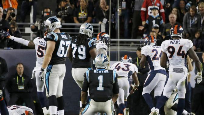 Carolina Panthers' quarterback Newton watches as Denver Broncos' Ward recovers his fumble in the fourth quarter of the NFL's Super Bowl 50 football game in Santa Clara