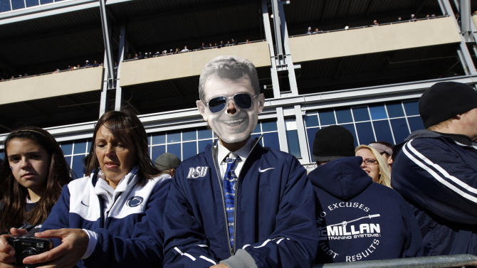 Thayne Russell, 16, from Hollidaysburg, Pa., wears a Joe Paterno mask outside Penn State's Beaver Stadium before their game with the University of Nebraska Saturday, Nov. 12, 2011 in State College, Pa. Penn State is playing for the first time in decades without former head coach Joe Paterno, after he was fired in the wake of a child sex abuse scandal involving a former assistant coach. (AP Photo/Alex Brandon)