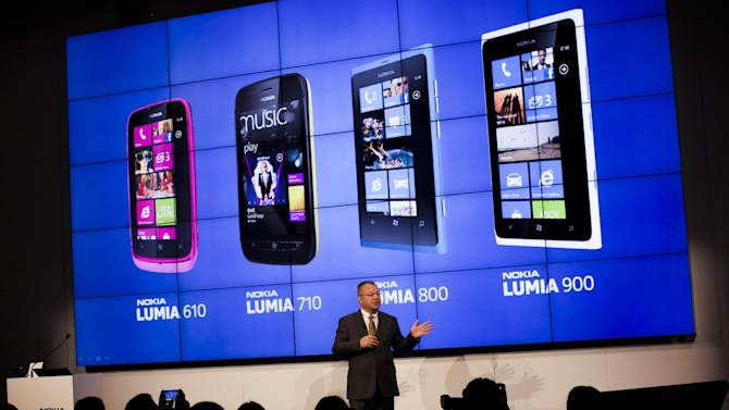 The chief executive officer of Nokia Corporation Stephen Elop, talks to the journalists during a press conference at the Mobile World Congress in Barcelona, Spain, Monday, Feb. 27, 2012. Struggling cell phone maker Nokia Corp. has unveiled two new handsets that it hopes will revive its fortunes at the start of the world's largest mobile phone trade show on Monday. (AP Photo/Emilio Morenatti)