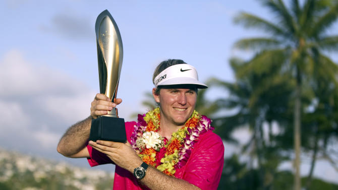 Russell Henley holds the trophy after winning the Sony Open golf tournament, Sunday, Jan. 13, 2013, in Honolulu. (AP Photo/Marco Garcia)
