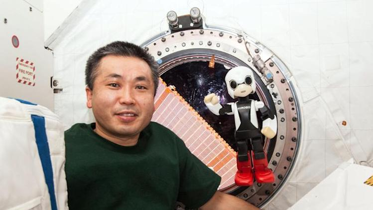 "Japanese astronaut Koichi Wakata stands next to the robot ""Kirobo"" (R) in the International Space Station, in this KIBO Robot Project, released December 20, 2013"