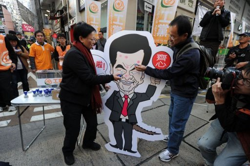 <p>Protestors stamp a placard of the city's leader Leung Chung-ying during an anti-Leung protest, in Hong Kong, on January 1, 2013. Tens of thousands of protesters are expected to rally in Hong Kong on January 1, calling for the city's embattled chief executive to quit and for greater democracy. AFP PHOTO / ANTONY DICKSON</p>