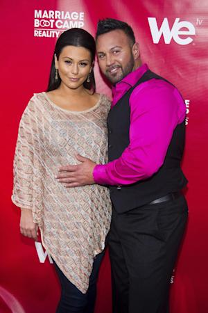 "FILE - In this May 29, 2014 file photo, Jenni ""JWoww"" Farley, left, and Roger Mathews attend WE tv's ""Marriage Boot Camp: Reality Stars"" party in New York. On Sunday, July 13, 2014, Farley gave birth to her first child. MTV officials say Meilani Alexandra Mathews _ who weighed 7 pounds, 13 ounces _ was born at 12:49 p.m. Sunday. A representative for Farley said both mother and daughter are doing well. The child's father is Farley's fiance, Roger Mathews. (Photo by Charles Sykes/Invision/AP,file)"