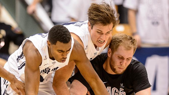 From left to right, BYU guard Anson Winder, BYU forward Luke Worthington and Gonzaga  center Przemek Karnowski (24) scramble for a loose ball during an NCAA college basketball game in Provo, Utah, Saturday, Dec. 27, 2014. (AP Photo/The Salt Lake Tribune, Trent Nelson) DESERET NEWS OUT; LOCAL TELEVISION OUT; MAGAZINES OUT