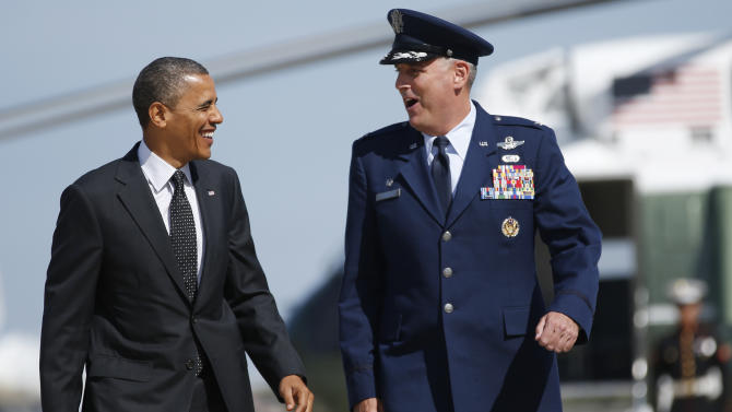 President Barack Obama walks with Col. Michael Minihan from Marine One to board Air Force One, Thursday, Sept. 20, 2012, in Andrews Air Force Base, Md., en route to Florida. (AP Photo/Carolyn Kaster)