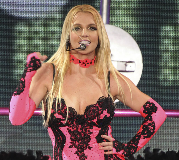 FILE - In this Sept. 24, 2011 file photo, singer Britney Spears performs on a stage during a concert in Moscow, Russia, during her European tour.  A source says she is joining Simon Cowell's singi