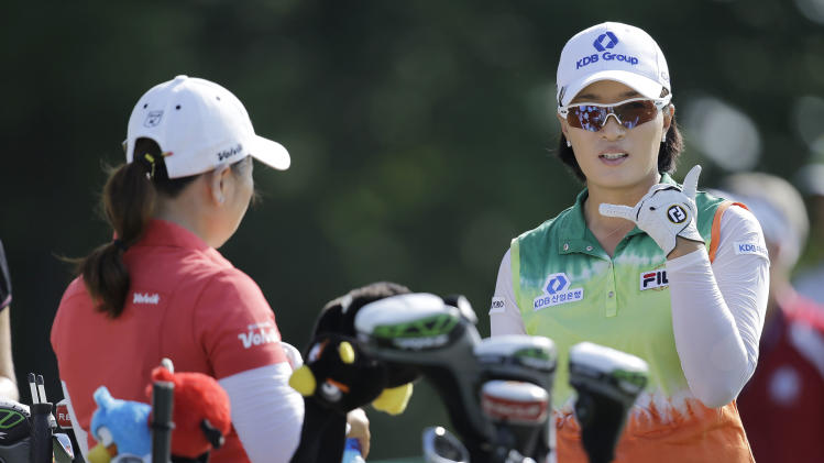 Se Ri Pak,  of South Korea, talks with  Jeong Jang, also of South Korea, before teeing off on the second hole during the first round of the U.S. Women's Open golf tournament, Thursday, July 5, 2012, in Kohler, Wis. (AP Photo/Julie Jacobson)