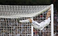 Real Madrid's Portuguese forward Cristiano Ronaldo reacts during the match against Barcelona on August 29, 2012. Having claimed the season's first piece of silverware with victory over Barcelona in the Spanish Super Cup, Real Madrid return to domestic action needing to close a five-point deficit on the Catalans in La Liga