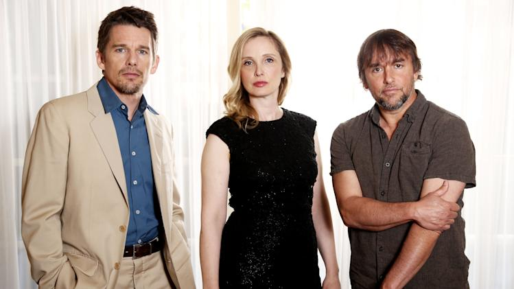 "In this Monday, May 20, 2013 photo, from left, actor and writer, Ethan Hawke, actress and writer, Julie Delpy and director and writer, Richard Linklater, from the film ""Before Midnight,"" pose for a portrait in Los Angeles. This is the third drama film in the series of walking, talking European romances. The movie releases in the US on Friday, May 24, 2013. (Photo by Matt Sayles/Invision/AP)"