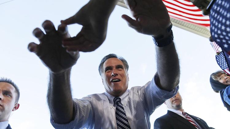 In this Nov. 3, 2012 file photo, Mitt Romney reaches out to shake hands with supporters as he campaigns at Colorado Springs Municipal Airport in Colorado Springs, Colo. (AP Photo/Charles Dharapak, File)