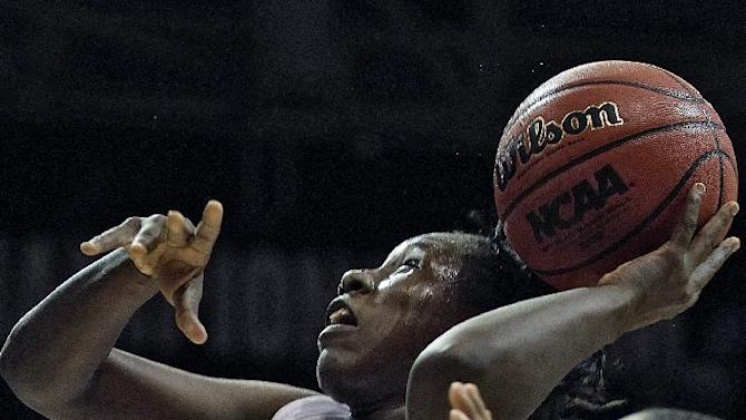 CORRECTS BYLINE - South Carolina forward Aleighsa Welch, left, grabs a rebound from Kansas guard CeCe Harper during the second half of a second-round game in the women's NCAA college basketball tournament on Monday, March 25, 2013, in Boulder. Colo. (AP Photo/Brennan Linsley)