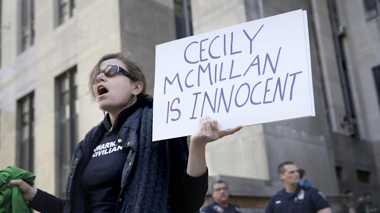 Sarah Wellington stands in front of the courthouse after the sentencing of Cecily McMillan in New York, Monday, May 19, 2014. McMillan, an Occupy Wall Street activist convicted of assaulting a police officer, was sentenced to 90 days in jail on Monday. (AP Photo/Seth Wenig)