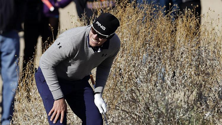 Hunter Mahan smiles after failing to hit out of the grass on the 17th hole in the final round of play against Matt Kuchar during the Match Play Championship golf tournament, Sunday, Feb. 24, 2013, in Marana, Ariz. Kuchar won 2 and 1. (AP Photo/Ted S. Warren)