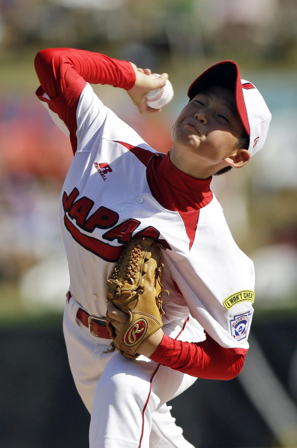 Hamamatsu City, Japan's Shoto Totsuka pitches in the first inning of a baseball game against Langley, British Columbia at the Little League World Series, Tuesday, Aug. 23, 2011, in South Williamsport, Pa. Hamamatsu City, Japan won 4-0. (AP Photo/Matt Slocum)