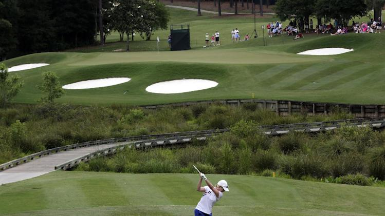 Karrie Webb of Australia tees off on the eighth hole during the final round of the Mobile Bay LPGA Classic golf tournament at the Robert Trent Jones Golf Trail at Magnolia Grove in Mobile, Ala. Sunday, May 19, 2013. (AP Photo/Dave Martin)