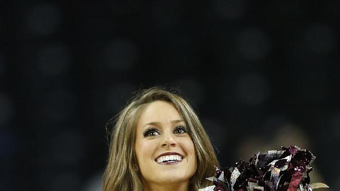 A Texas A&M dancer performs in the first half of an NCAA college basketball game in the semifinals of the Southeastern Conference women's basketball tournament Saturday, March 8, 2014, in Duluth, Ga. (AP Photo/John Bazemore)