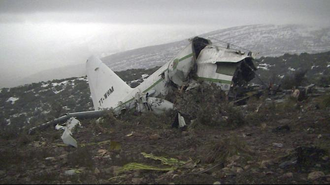 The wreckage of an Algerian military transport plane which slammed into a mountain Tuesday in the country's rugged eastern region, is pictured Wednesday, Feb. 12, 2014. The crash killed scores of people and left just one survivor, the defense ministry said. The plane was discovered in pieces on Mount Fortas near the town of Ain Kercha, 50 kilometers (30 miles) southeast of Constantine, the main city in eastern Algeria. (AP Photo/Anis Belghoul)