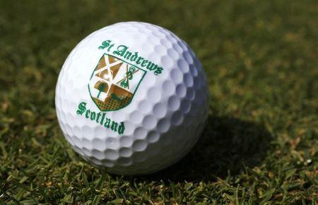 A St. Andrews souvenir golf ball is seen on a golf course in London