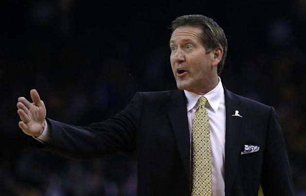 Phoenix Suns coach Jeff Hornacek gestures from the sideline during the first half of an NBA basketball game against the Golden State Warriors Sunday, March 9, 2014, in Oakland, Calif