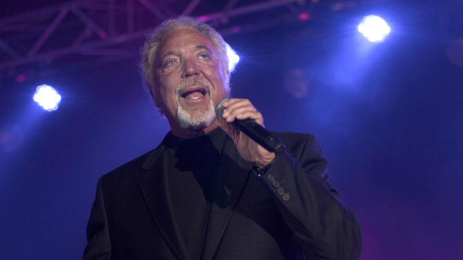 FILE - In this Nov. 13, 2011 file photo, singer Tom Jones performs during a concert in Beirut, Lebanon. Jones has apologized to fans after pulling out of an Olympic celebration concert in London after contracting bronchitis. The 72-year-old Welsh crooner had been due to entertain tens of thousands of people at the outdoor concert in Hyde Park on Saturday, July 28, 2012. He was replaced by British singer Will Young. (AP Photo/Hussein Malla, File)