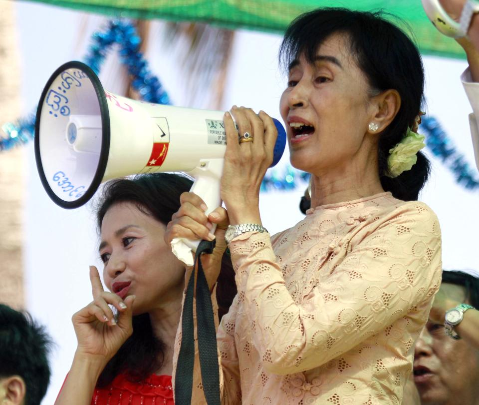Myanmar pro-democracy icon Aung San Suu Kyi speaks to her supporters during her election campaign for the April 1 by-election in Myeik Archipelago Village in Myeik, Tanintharyi division, the southern most part of Myanmar, Saturday, March 24, 2012. (AP Photo/Khin Maung Win)