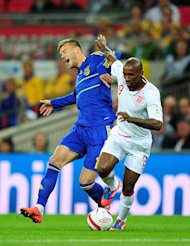 England's Jermain Defoe (right) in action against Ukraine