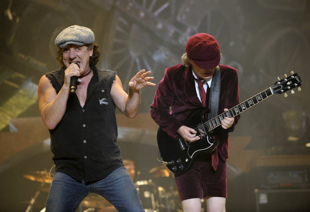 "FILE - In this Nov. 12, 2008 file photo, AC/DC lead singer Brian Johnson, left, and Angus Young perform on the Black Ice tour at Madison Square Garden in New York. Columbia Records and Apple announced Monday, Nov. 19, 2012, that the classic rock band's music will be available at the iTunes Store worldwide. Sixteen albums will be released, including ""High Voltage"" and ""Back in Black."" (AP Photo/Jeff Zelevansky, file)"